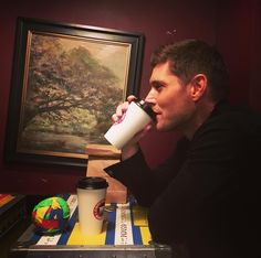Jensen drinking coffee with SPN Tape Ball... He looks f**king gorgeous in this picture... Like more than usual.