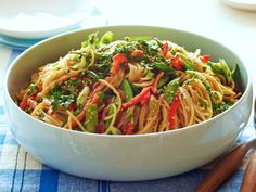 Crunchy Noodle Salad : Ina coats thin spaghetti in a sweet-pungent dressing made from rice vinegar, soy sauce, honey, ginger and peanut butter. Fresh vegetables add color and crunch — fitting for an outdoor gathering.