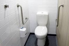 In addition to a required accessible toilet an ambulant toilet suitable for a person with an ambulant disability must also be provided for males and females Cubicle Door, Toilet Cubicle, Unisex Toilets, Resort Plan, Privacy Lock, Toilet Roll Holder, Laundry In Bathroom, Entry Doors, Disability