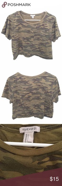 FOREVER 21 camo crop top This camo crop top is so cute and blends in well with other trends. It's a bit faded (see pictures) but still very wearable! Forever 21 Tops Crop Tops