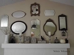 Love the collection of old mirrors and how they are displayed above the mantel!