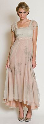 $220 Spring Dance Dress Plus Sizes    Her dance card was full. Embroidery waltzes upon subdued layers of blush and celery. A French hem reveals pretty shoes with extended length in back. Sheer poofy sleeves, high waist, flattering bias-cut skirt and side zip.