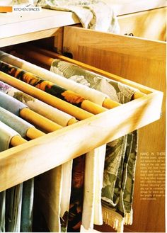 Butler Pantry pull out with dowels for tablecloths and tablerunners...great idea!