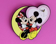 Mickey and Minnie Mouse Wall Clock - Kids & Baby Room Decoration - Nursery Decor Gift. $29.99, via Etsy.