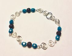 Excited to share this item from my shop: Aromatherapy oil diffuser lava bead bracelet with teal colored beads and S swirl silver wire links Glass Jewelry, Wire Jewelry, Beaded Jewelry, Aromatherapy Jewelry, Aromatherapy Oils, Link Bracelets, Beaded Bracelets, Star Earrings, Czech Glass Beads