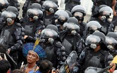 Indigenous demonstrators protest development of their land at Rio+20