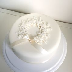Snowflake Wreath Christmas Cake snowflakes can be cut from fondant, gumpaste or piped in royal icing. All white