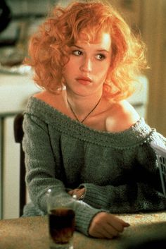 Molly Ringwald. Oversized green off-the shoulder sweater, sexy mess of red hair, glass of Pepsi.