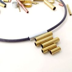 Sometimes less is more! This DIY pendant takes less than 10 minutes and nails the minimalist metallic trend!