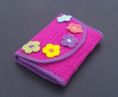 Crochet hook case pattern  This one is smart with places for the extras like scissors and measuring tape.