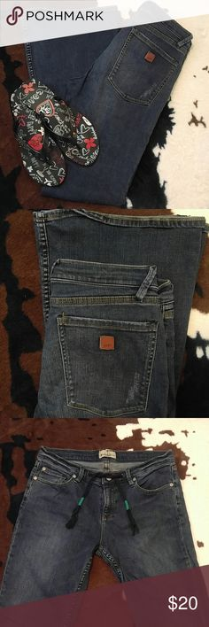 Roxy jeans Denim by Roxy. So cute and so comfortable! Rope drawstring belt and cute little patch on the back pocket accent. Wider flare and a medium wash. Size 11 and in perfect condition. Roxy Jeans Flare & Wide Leg