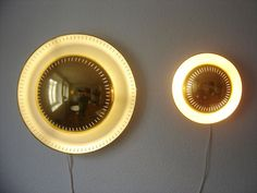PAIR OF RARE MODERNIST WALL LIGHTS | CEILING LAMPS | SCONCES MID CENTURY | MANUFACTURED IN 1950s | SARFATTI | STILNOVO ERA  HIGHLY DECORATIVE WALL LIGHTS | CEILING LAMPS | SCONCES Up for sale an extremely rare and highly decorative pair of original mid century modern wall lights / ceiling lamps with perforated brass shades. Manufactured in 1950s. The large lamp with a diameter of 50 cm needs 3 x E27, the other one 2 x E14 screwfit bulbs. Delivery without bulbs.   MATERIAL: Brass sheet; p...