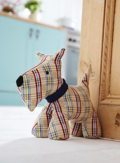 An Ulster Weavers design Shaped door stop Cotton with sand polyester filling Sponge clean only Size Height 26 cm x Base 27