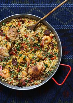 Chicken, Shrimp, and Chorizo Paella - spanish chorizo, olive oil, chicken thigh, onion, garlic, tomato, parsley, paprika, chicken broth, saffron, arborio, shrimp, pea