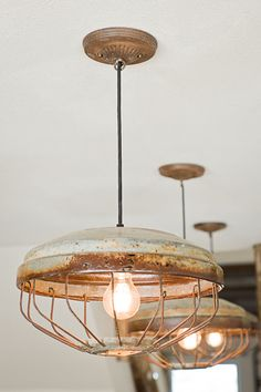 Love the idea of these vintage chicken coop light fixtures though my ceilings are not high enough to use them.