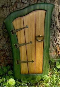 I've seen these neat little doorways that u can place to create the look of a fairy home or entryway. Cute!