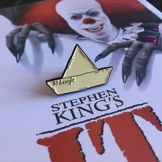 Where IT all starts, with Georgie Denbroughs ill fated paper boats maiden voyage. The S.S Georgie led us all to our worst nightmare, Pennywise. Join the Losers Club! Soft enamel pin badge with black clasp and individually drawn backing card. 30mm in length LAST POSTING DATES FOR