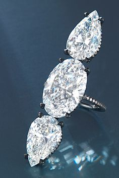 Ring of 10.67ct oval-shaped and two 6ct diamonds by JAR, est. $ 2.5-3.5 million at Chrisite's HK May 29 (Chrisite's Images)     Whoah! a girl can dream, can't she?