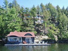 Construction complete ~ Muskoka cottage for sale.  Spectacular views.  Sunsets. Fireplace, inside and out.  2 car, 2  bed coach house. 2 slip boathouse.