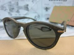 WAITING FOR THE SUN LA UNE WOOD SUNGLASSES (vintage black) by Waiting for the sun. $185.00. Waiting For The Sun offers a range of glasses combining lightness, comfort, quality and aesthetic appeal. Fashioned from natural wood, a renewable substance to reduce the ecological footprint. Tested and selected with care, all materials used are submitted to strict quality checking. Structured by the natural veins of the wood and handcrafted, each Waiting For The Sun pair of gla...