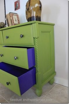 Dresser turned TV console. Love this! Especially the colored drawer sides and the top drawers converted into storage shelves.