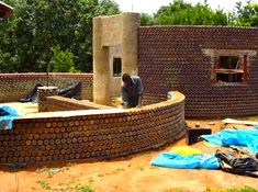 House in Nigeria made from plastic bottles filled with sand. Bullet proof, fire proof