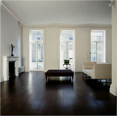 If we ever re-finish our wood floors I think I would like to do this rich deep color. it seems so warm to me!