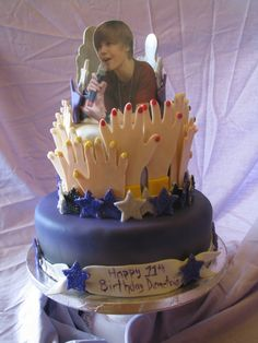 Look at those hands reaching out for their Bieber god. Says the creator of this cake:     This cake was for a little girls 11th birthday. I took the idea of the hands from the Wilton bridal shower cake. When I think of these young cute singers, I have visions of hands in the air and girls screaming. Justin is printed on edible paper and layed out onto gumpaste. All hands and decos are fondant. The stars have edible glitter on them to make them shimmer. I am very happy with how it turned out!...