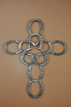 Horseshoe Cross with Star by AmericanSteel on Etsy https://www.etsy.com/listing/184218012/horseshoe-cross-with-star