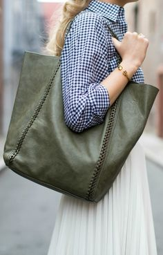 grey suede booties for spring, white pleated skirt, navy gingham shirt, olive tote bag