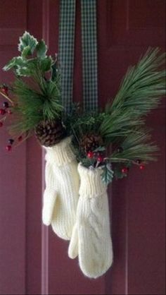 Winter gloves give a lil whimsy to this winter decor..I might try non matching mittens for mine with a bell perhaps