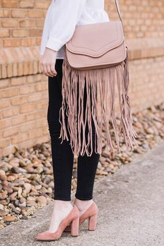 We love the way The Style Scribe adds a touch of boho chic to her look with this BCBGeneration Fringe Bag!