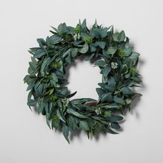 Bring a bit of greenery into your dwelling with this Eucalyptus Wreath from Hearth & Hand™ with Magnolia. Adding a fresh element to your space, this decorative wreath will bring the outdoors into your home with its eucalyptus leaves and twig-like backing. Perfect to hang above your mantel or inside of a wooden picture frame, this indoor wreath will balance out your decor in a way that you'll love.<br><br>Celebrate the everyday with Hearth & Hand — cr...