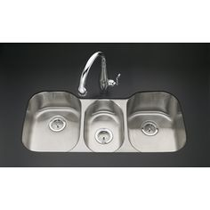 Three bowl sink replaces dishwasher - one bowl is always filled with water  for soaking.