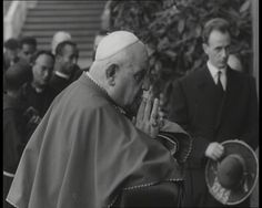 Pope John XXIII prays in the Vatican Grottos. Watch footage of the pope from his tenure: http://www.britishpathe.com/workspaces/BritishPathe/YWirLPR5