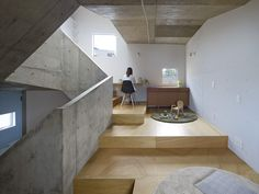 House in Nishiochiai is a minimalist house located in Tokyo, Japan, designed by Suppose Design Studio. The home features a concrete construction that is exposed on the inside. A staircase hugs the perimeter of the house, and leaves a space in the center to allow light from the skylight to penetrate the interior.