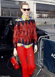 Style queen: Karlie Kloss displayed her flair for fashion as she stepped out in an eye-cat. Louis Vuitton Shirts, Stepping Out, Karlie Kloss, Printed Shirts, Catwalk, Crowd, Trousers, Fashion Finder, Leather Jacket
