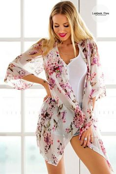 Get more excited for summer with this breezy white floral chiffon kimono.