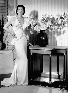 "Kay Francis in ""Living on Velvet"" (1935).Gowns by Orry-Kelly."