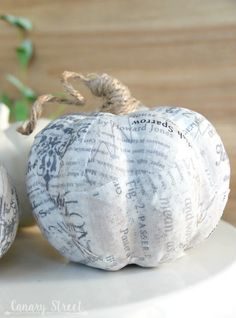 Easy way to update faux pumpkins! Use Mod Podge to cover faux pumpkins with any fabric or paper. Wrap twine around the stem. Autumn Crafts, Thanksgiving Crafts, Holiday Crafts, Pumpkin Crafts, Diy Pumpkin, Tree Crafts, Paper Crafts, Fall Projects, Diy Projects To Try
