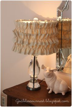 """""""I purchased the lamp from Pottery Barn and made the shade myself. I just cut 3 strips of muslin, ruffled them, and glued them to a cheap shade."""" @Andrea Smith-Gillespie, we are so doing this for baby SGs room!"""