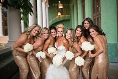 Im in love with her dress and the bridesmaid dresses as well. Maybe my girls should wear gold with red flowers.