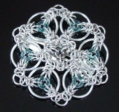Celtic Triskele is my own design which is formed into units. These units are then connected to make various types of jewelry. The Celtic Triskele chainmail barrette is featured as part of my tutorial available in the Store section.