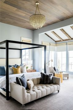 urban loft style master bedroom idea for a dream home - recreate this look in your room by adding a bench to the foot of your bed and punching the room up with mixed and matched pillows