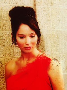 """""""Okay, maybe I don't go around loving everybody I meet, maybe my smiles are hard to come by, but I do care for some people."""" Katniss Everdeen."""