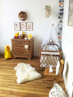 vintage and wood baby room, but I really looking at the baubles hanging down in the corner