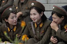 NORTH KOREAN MILITARY WOMEN | North Korean female soldiers smile before a parade to commemorate the ...