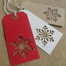 handmade christmas tags. Just a snowflake punch and some paper tags. lovely! The little drops of glitter add the perfect touch.