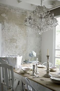 Seawashed - We are washing it in the grey-blues and whites of the winter sea...like this dining room by Rachel Ashwell