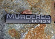 "1.5"" x 8"" dome faced ""Murdered Edition"" black powder coated badge with charcoal gray lettering.  For more info visit www.billetbadges.com.  #billetbadges #emblem #custom #madeinusa"